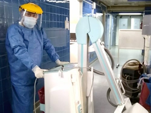 Juan Manuel with the portable X-ray equipment.