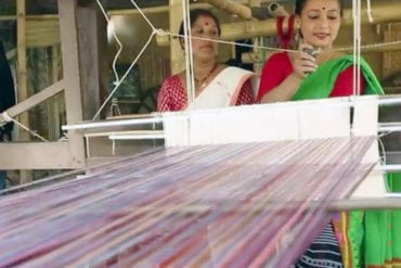 Rupjyoti Saikia Gogoi mixing plastic with cotton threads at her loom in Bocha Gaon village in Assam