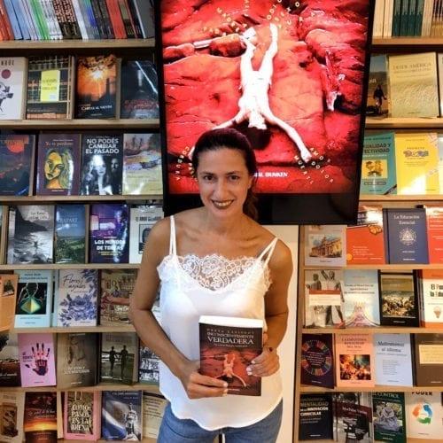 Greta Lapistoy poses with her book