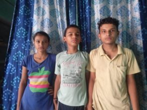 Rahul (right) and his younger siblings were orphaned by COVID-19