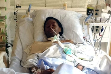 Irene Olumese seen laying in a hospital bed during one of her stays.