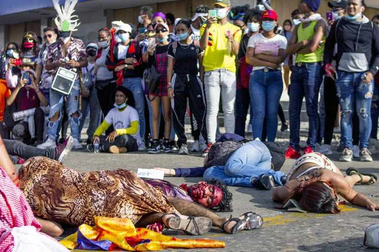 Young theater students from the Faculty of Fine Arts of the Atlantic University make an artistic exhibition referring to the murders in the midst of the national strike in Colombia