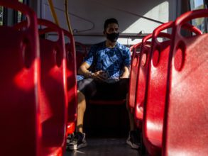 Joan Manga gets on the bus before anyone else each day on his way to the athletics stadium, an athlete and coach. Photo by David Moran.