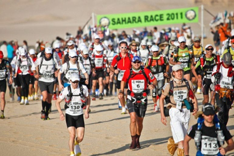 Runners compete in a marathon race through the Sahara in 2011.