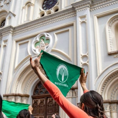 A photo of protesters waving abortion rights flags in Argentina.
