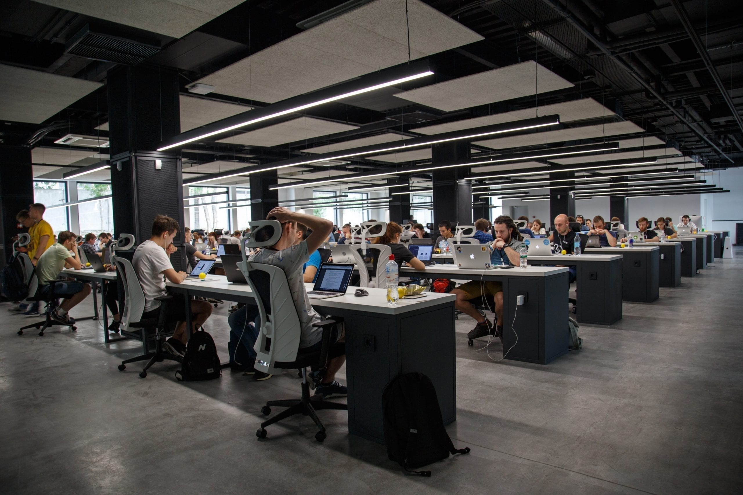 A photo illustration showing workers sitting at desks.