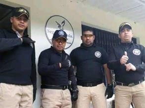 A photo shows Jean Carlo with a group of police officers before he was killed.