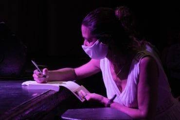 Greta Lapistoy writes in a journal.