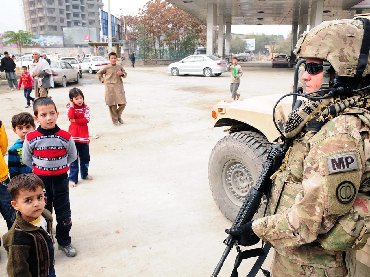 A soldier mentors Afghan police in Kabul.
