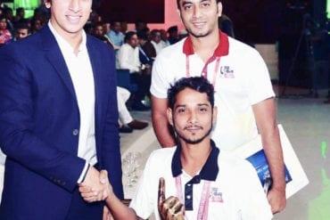 Mohammad Mohasin receiving the Taj Mahal Cricket championship Trophy