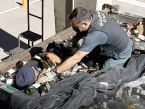 Spanish national police checking the containers where the bodies were found alive.