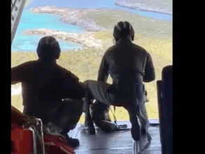 U.S. Coast Guard drops supplies to the stranded trio