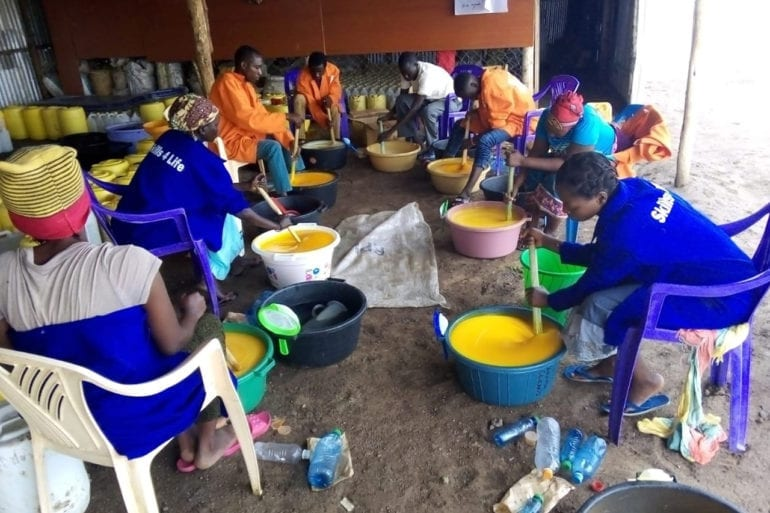 Refugees and locals work together to make soap for the Kakuma refugee camp in Kenya.