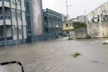 Flooding in Beira inner city. Roofs of many of the cities buildings are seen to have collapsed.