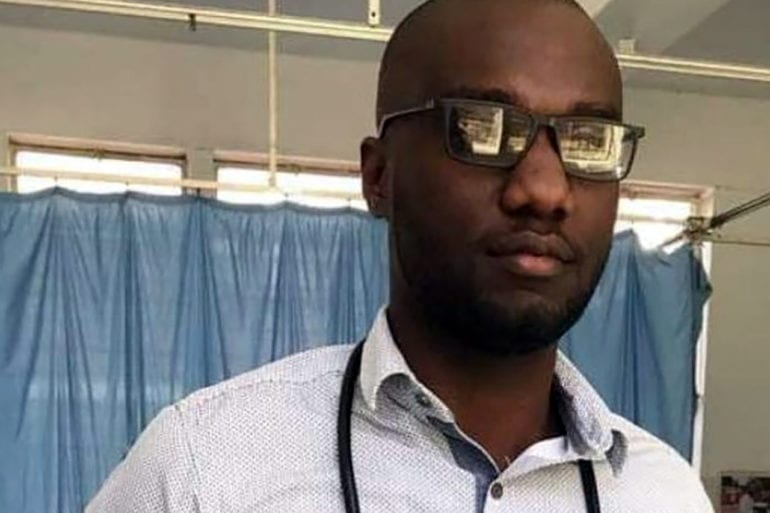 A Zimbabwean doctor looks into the camera during COVID-19.